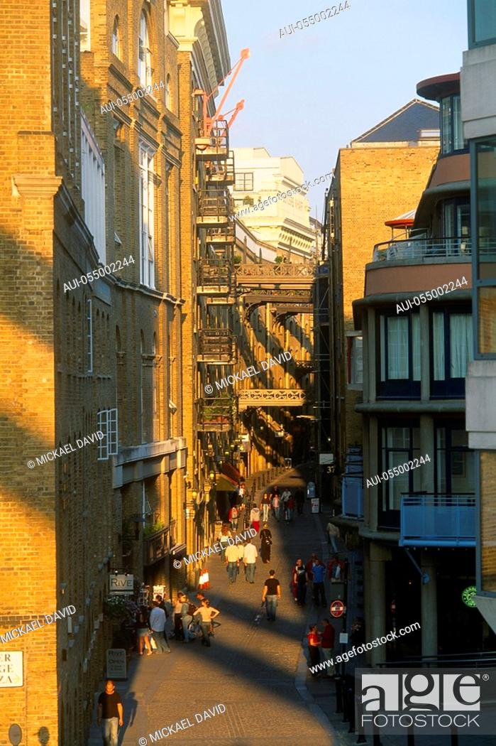 Stock Photo: England - London - Southwark district - Shad Thames - people walking on walkway.
