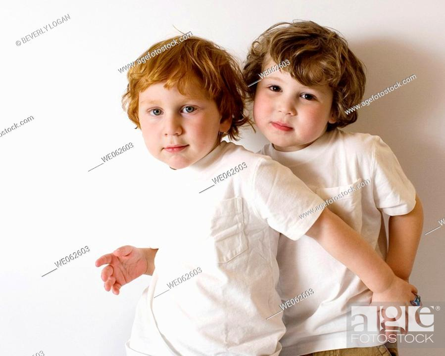 Stock Photo: Two three-year-old boys hugging.