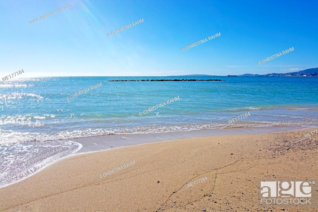 Stock Photo: Untouched sand beach with wave residue pattern and blue sea in Mallorca, Spain.