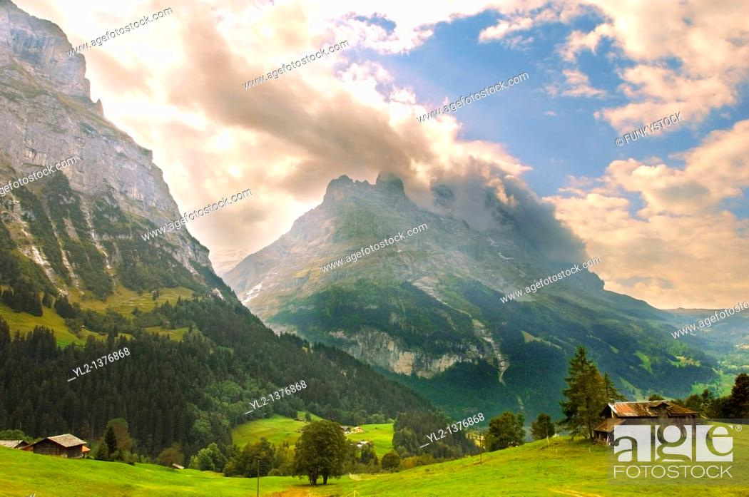 Stock Photo: The Eiger in Clouds at sunset above Grindelwld, Swiss Alps, Switzerland.