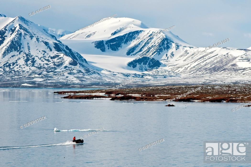 Stock Photo: Zodiac heads out to Andoyane island to look for polar bears, Liefdefjorden, northwest Svalbard, Norway, in summertime.