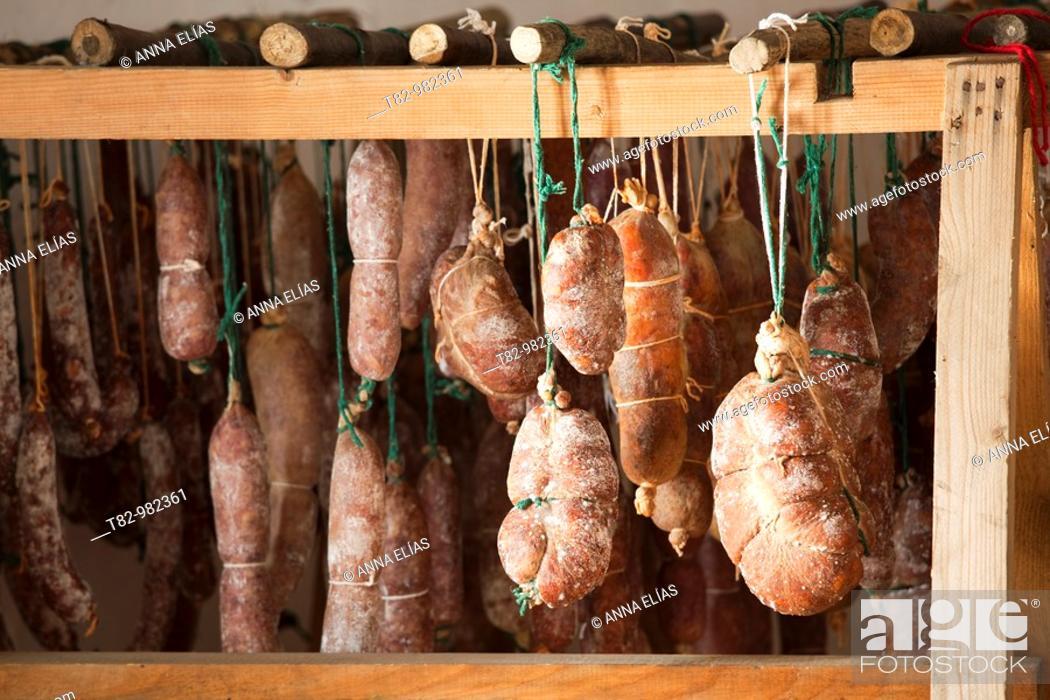 Stock Photo: drier Iberian pork sausages in the Sierra de Aracena, Huelva, Andalucia, Spain,secadero de embutidos de cerdo iberico en la Sierra de Aracena, Huelva, Andalucia.