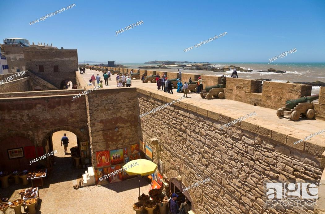 Stock Photo: People walking on the city walls, Essaouira, Morocco.