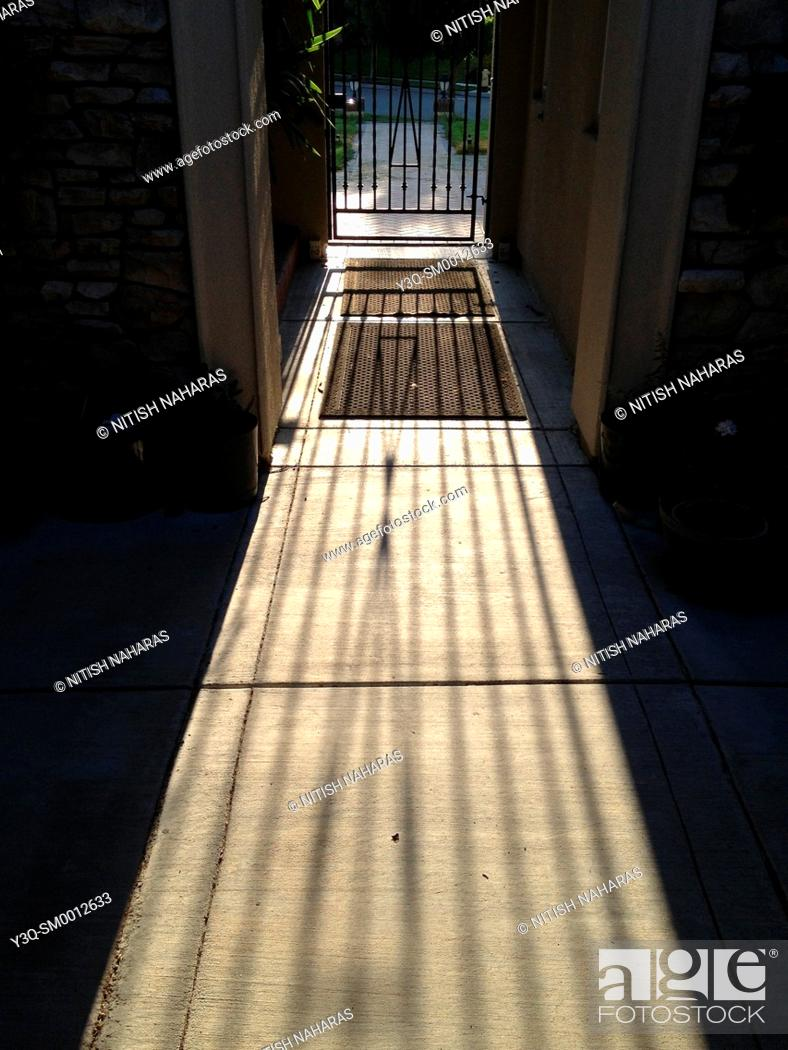 Stock Photo: 'Sun peeped through the iron grill and illuminated my whole day'.