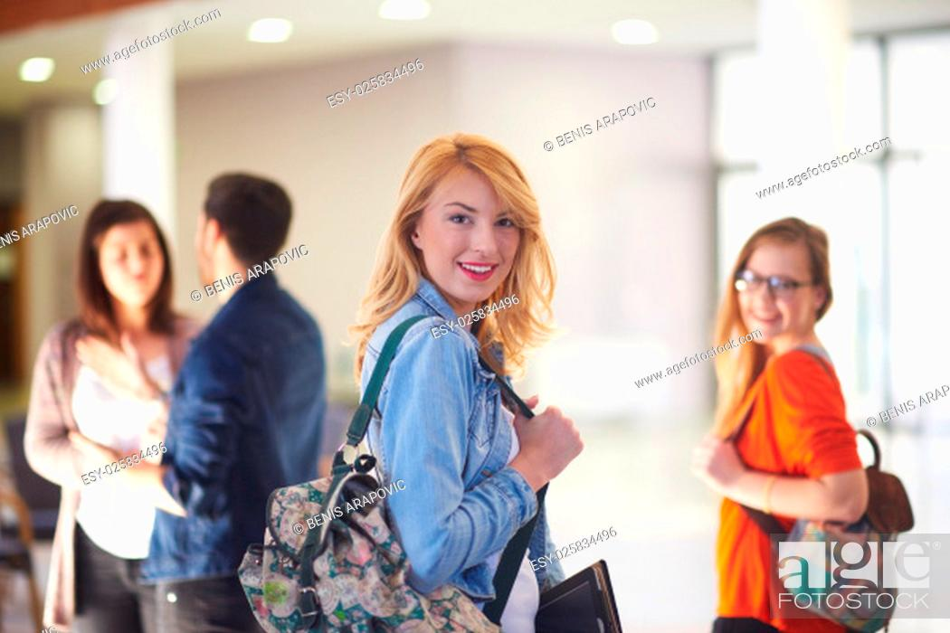Stock Photo: happy student girl working on tablet computer at modern school university indoors.