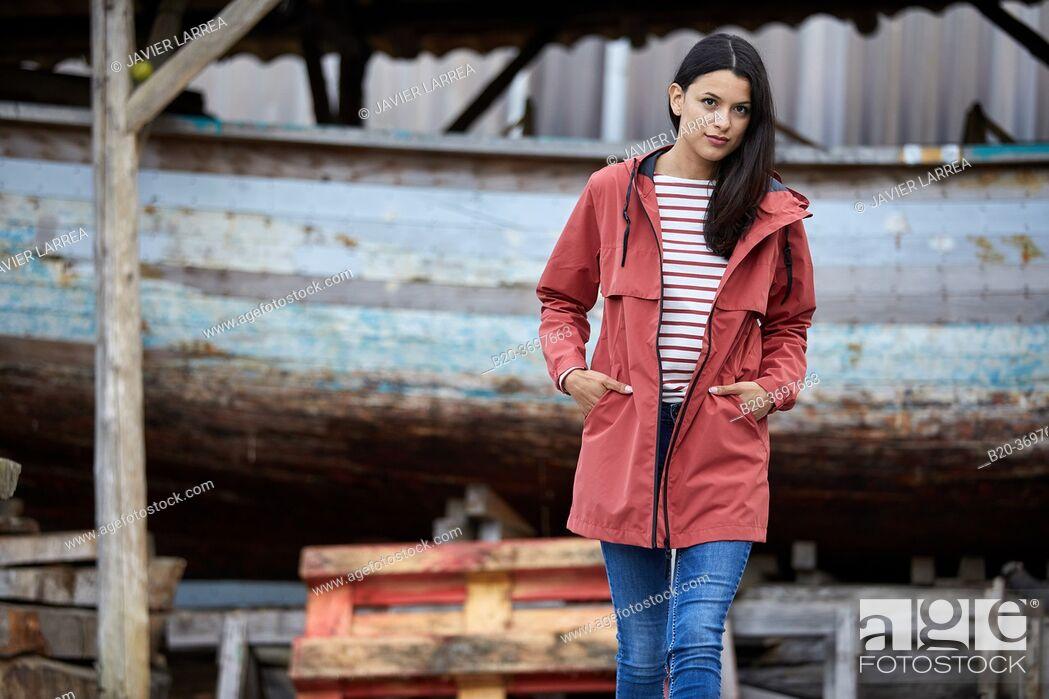 Stock Photo: Young woman with raincoat, Pasaia, Gipuzkoa, Basque Country, Spain, Europe.