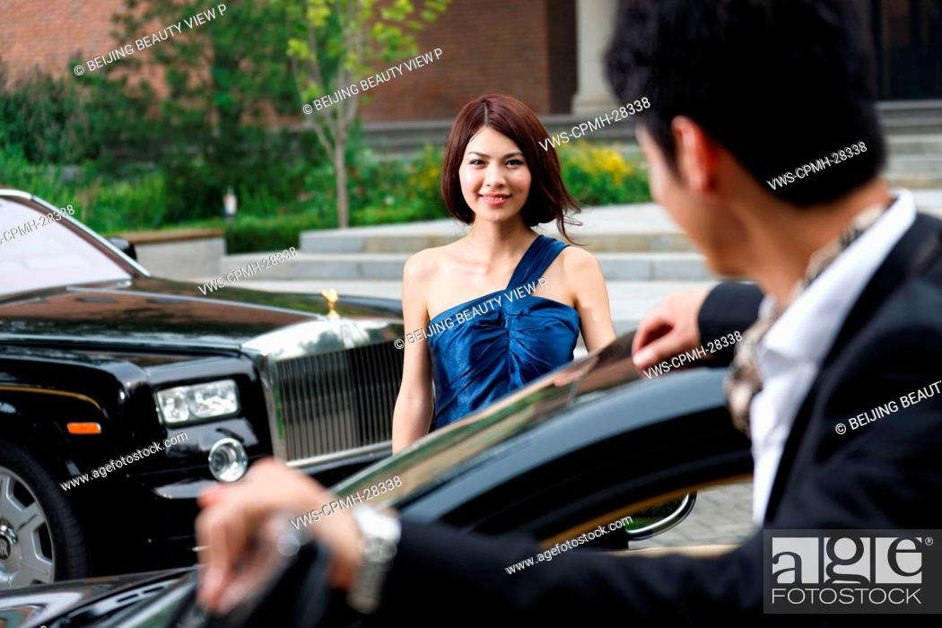Stock Photo: Young couple with limousine.