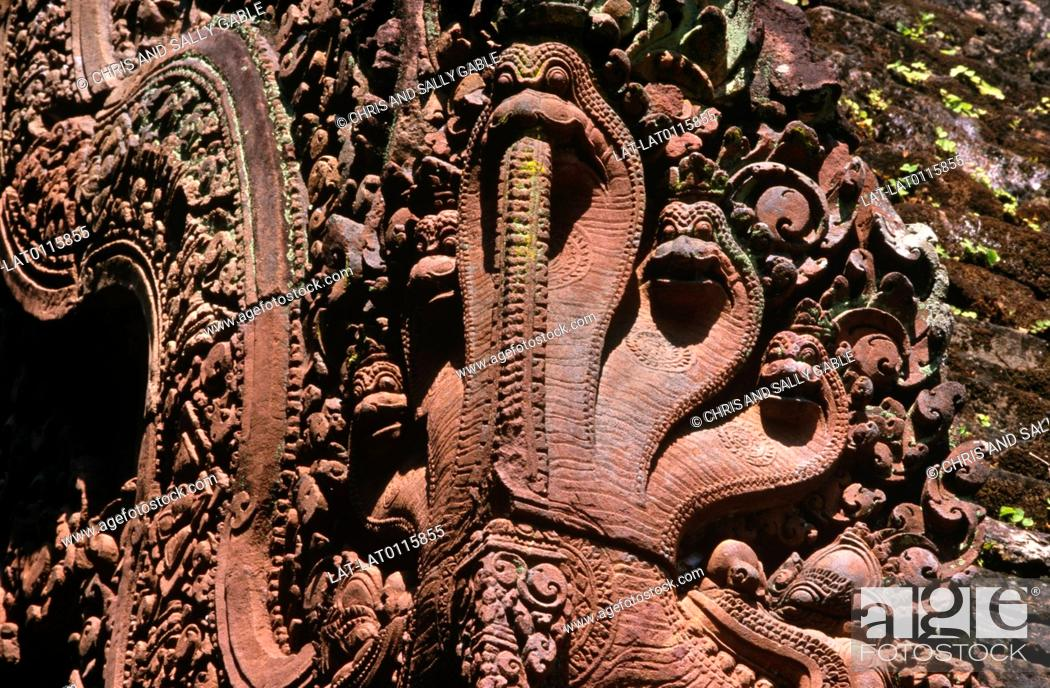 Stock Photo: Banteay Srei is a 10th century Khmer temple dedicated to the Hindu god Shiva. It is renowned for stone carvings in the red sandstone of the building.