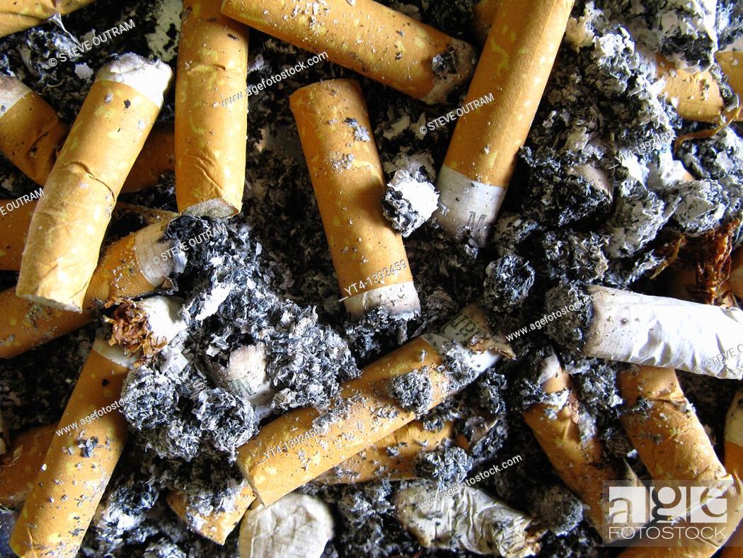 Stock Photo: Cigarettes in Tray.