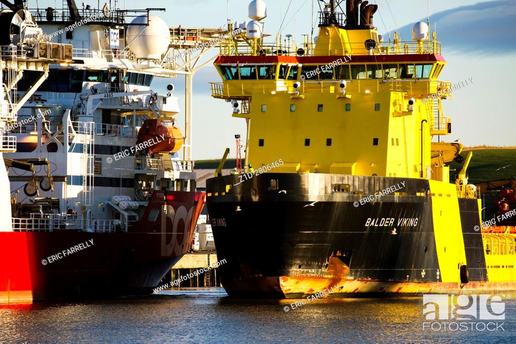 Imagen: two oil support ships manoeuvring to double beth. Montrose Harbour Scotland UK.