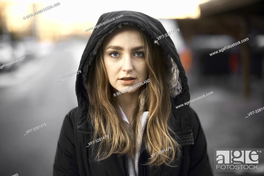 Photo de stock: young woman outdoors, wearing hooded anorak, winter clothing, in Cottbus, Brandenburg, Germany.