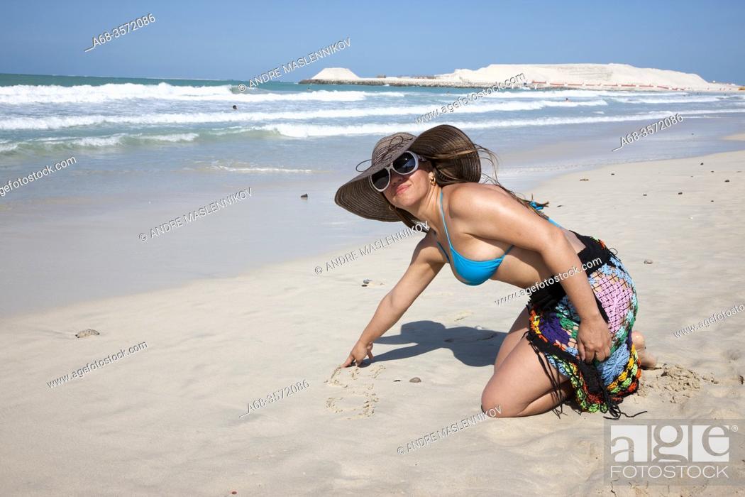 Stock Photo: Woman on Jumeirah beach in Dubai. Model release. Photo: André Maslennikov.