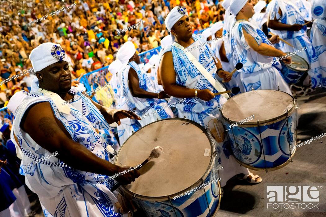 Stock Photo: The drums section of Portela samba school performs during the Carnival parade at the Sambadrome in Rio de Janeiro, Brazil.