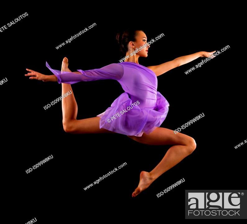 Stock Photo: Graceful ballerina in mid air.