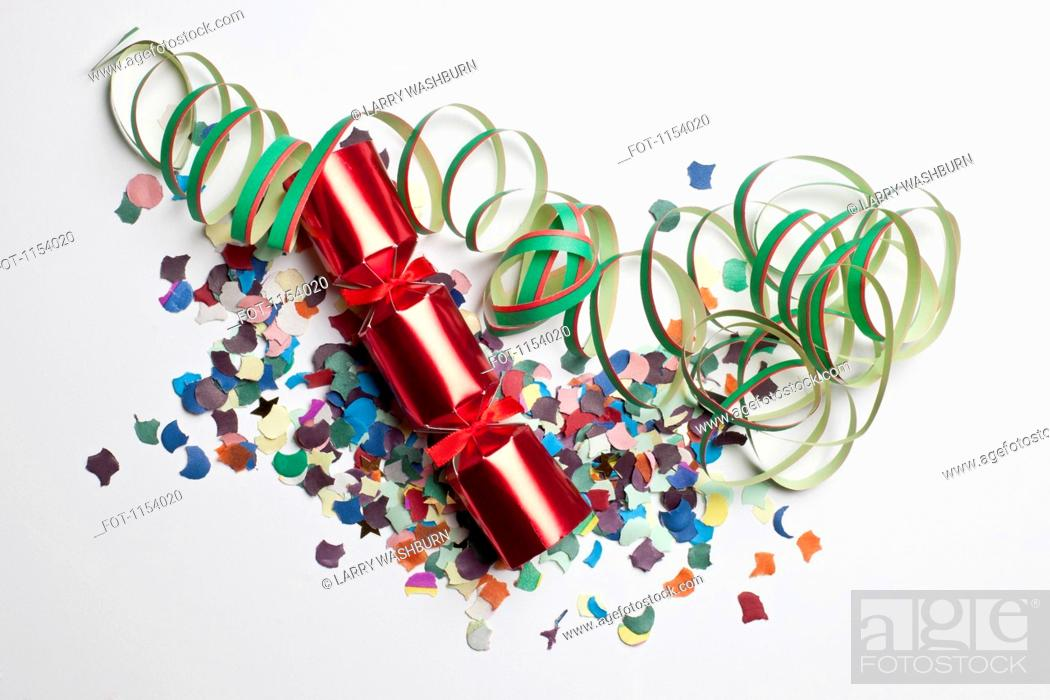 Stock Photo: Confetti, streamers and a Christmas cracker.