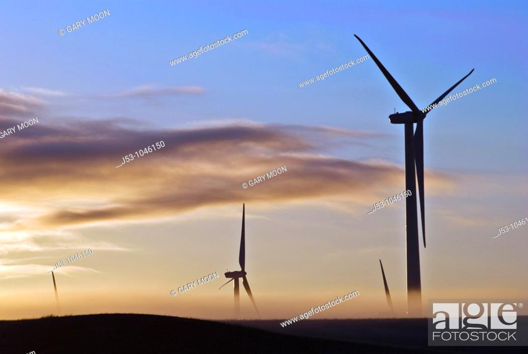 Stock Photo: Wind turbines silhouetted at dawn with ground fog, Judith Gap, Montana.