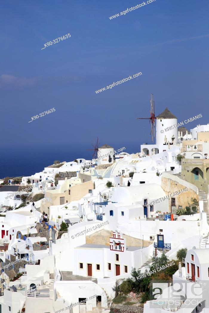 Stock Photo: Houses and windmills in Oia, Santorin, Greece, Europe.