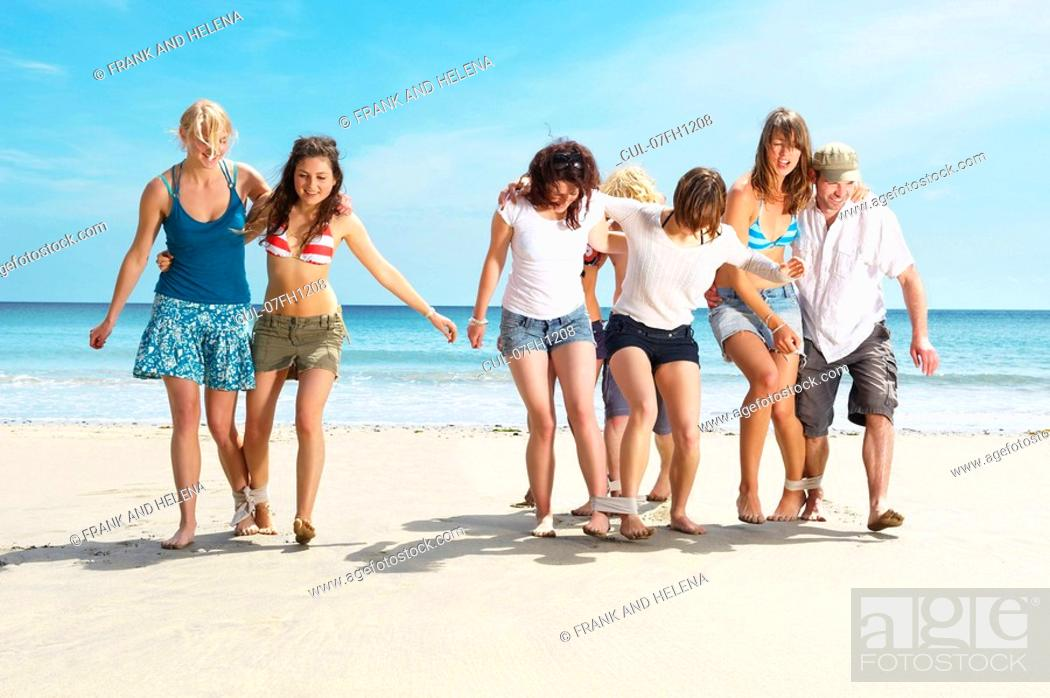 Stock Photo: Group racing on beach.