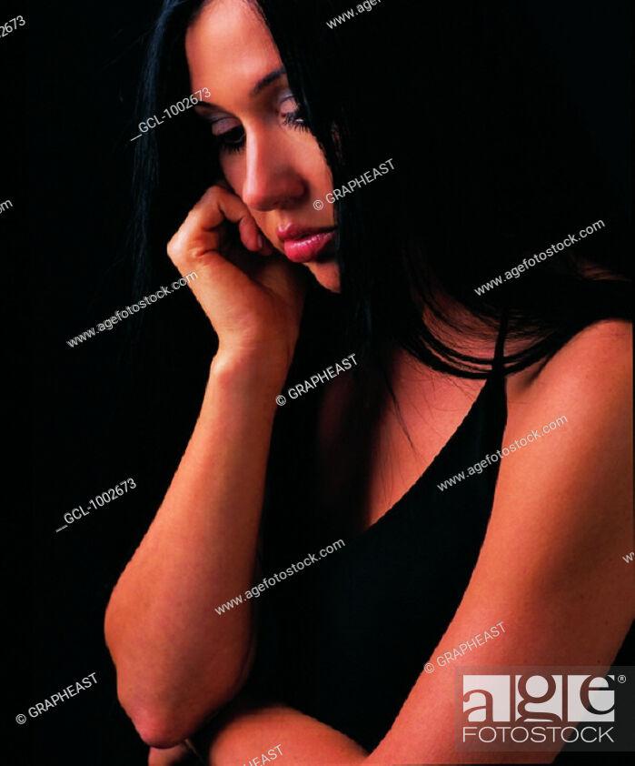 Stock Photo: Pensive woman.