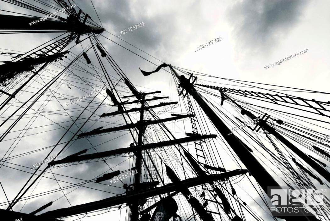 Stock Photo: Masts of a ship and heavy clouds.