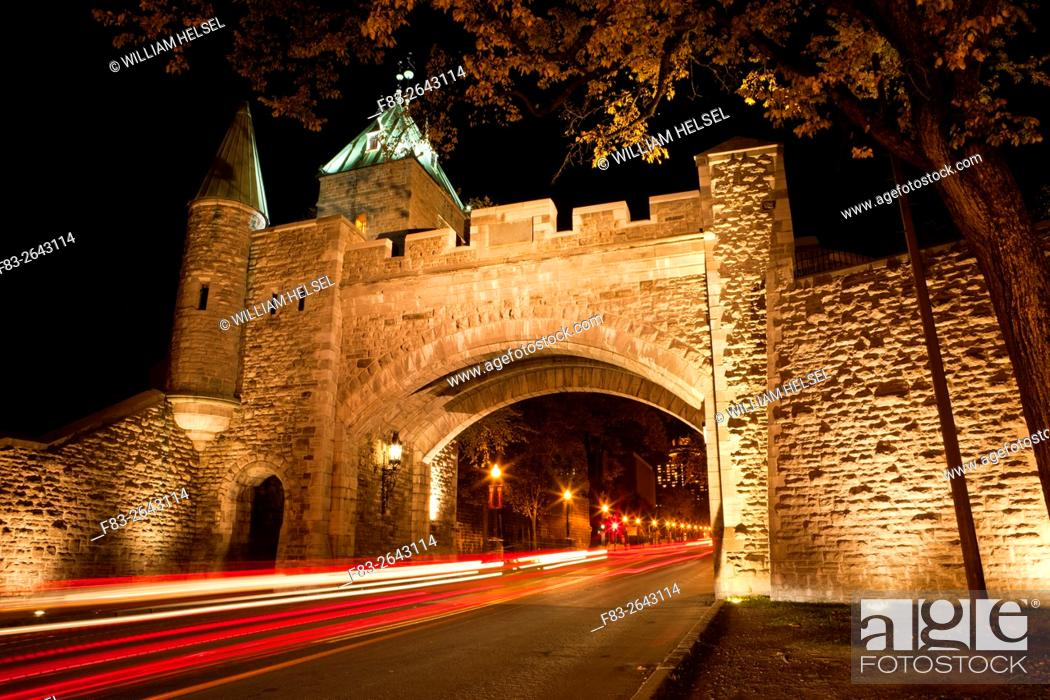 """Stock Photo: Gate (""""""""Porte St-Louis"""""""") in old city wall, Grande Allee beyond, Quebec City, Quebec, Canada, night."""