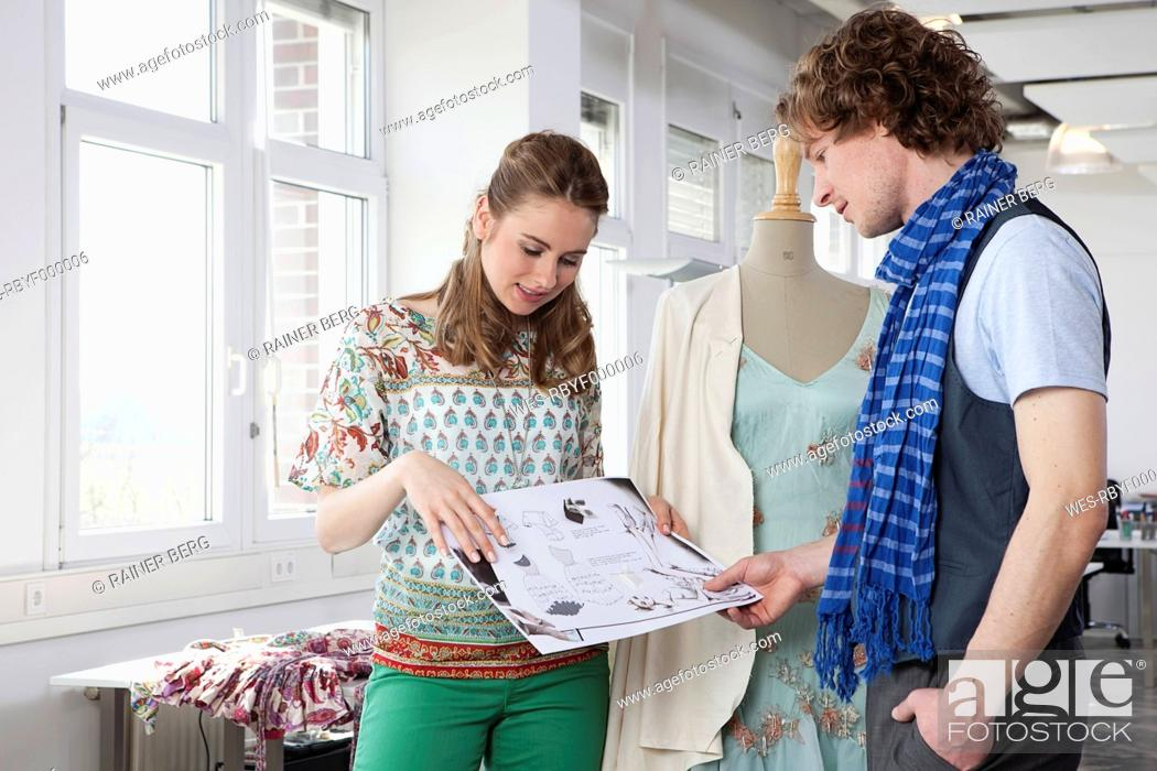 Stock Photo: Germany, Bavaria, Munich, Fashion designers in discussion.