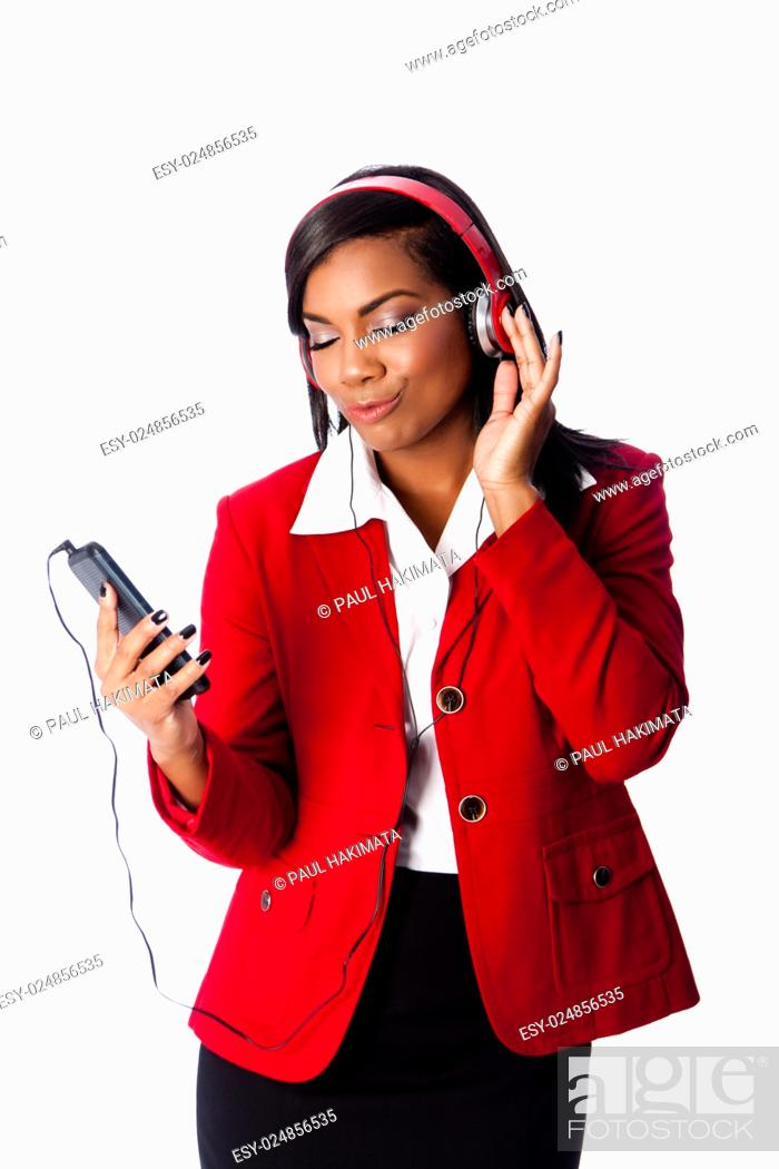 Stock Photo: Beautiful happy business woman jamming listening to music on wireless mobile phone, on white.