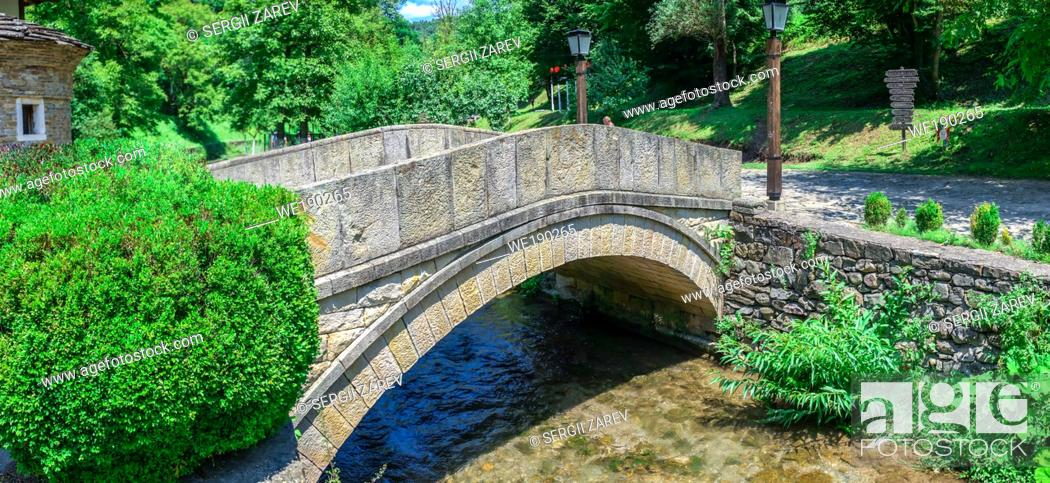 Stock Photo: Stone bridge in the Etar Architectural Ethnographic Complex in Bulgaria on a sunny summer day. Big size panoramic photo.