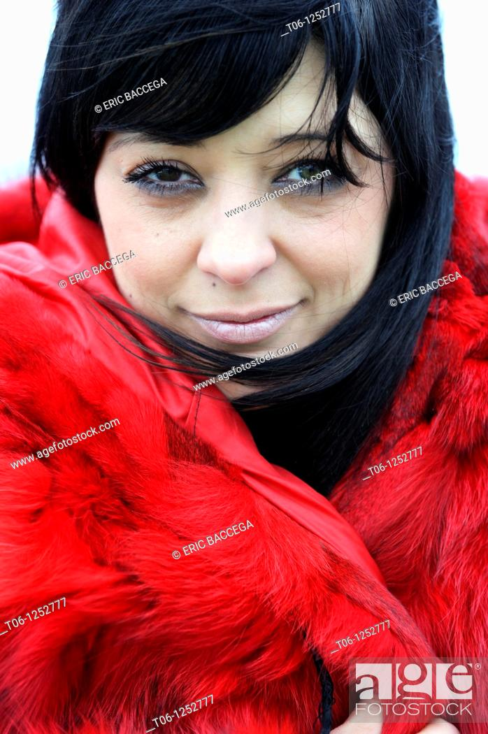 Stock Photo: Woman with two different colored eyes and red coat Heterochromia iridium.