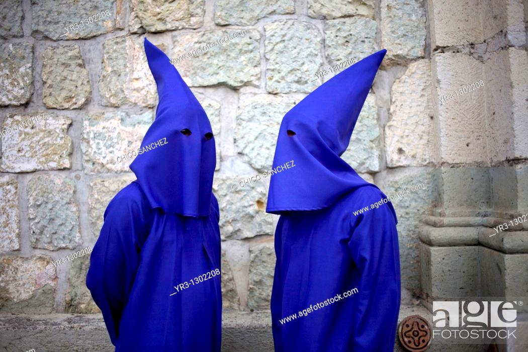 Stock Photo: Penitents speak before a holy week procession in Oaxaca, Mexico, April 10, 2009.