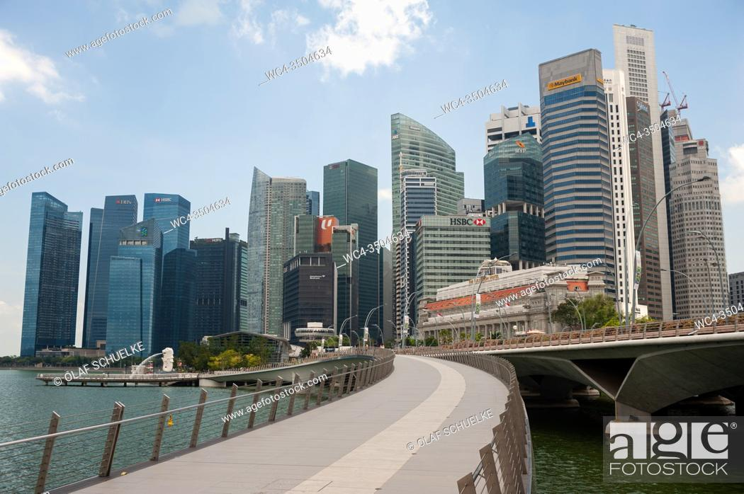 Stock Photo: Singapore, Republic of Singapore, Asia - View of the city skyline with skyscrapers in the central business district and the Jubilee Bridge along the waterfront.