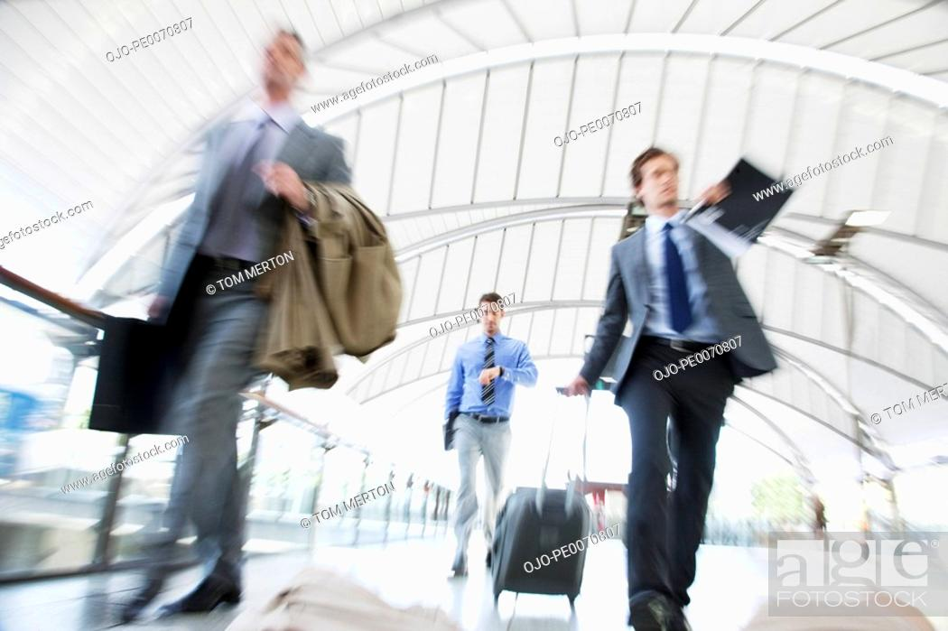 Stock Photo: Business people rushing in train station.