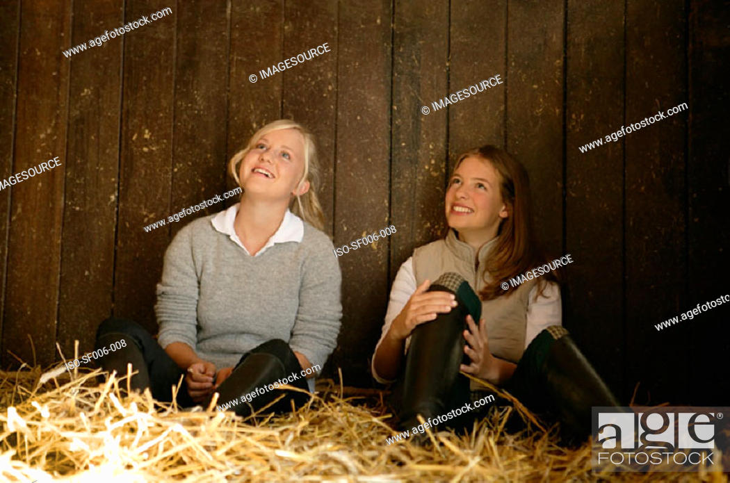 Stock Photo: Two young women in a stable.