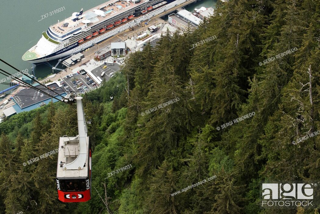 Stock Photo: Mount Roberts Tramway in Juneau dock, Alaska, USA. Juneau downtown, city. Alaska. USA. Celebrity Millennium cruise ship docked between snow capped mountains and.