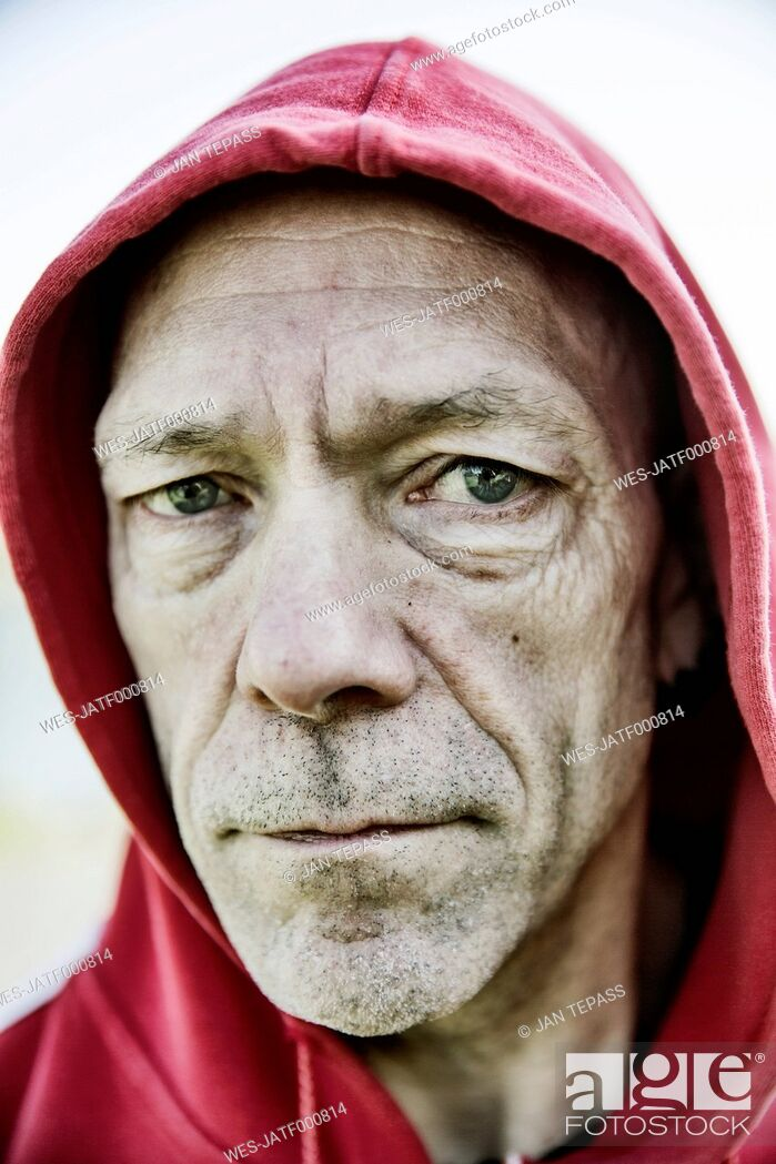 Stock Photo: Portrait of man with red hood.
