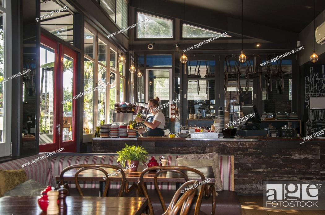 Stock Photo: A quiet morning at the Goat House Cafe beside the busy suburban station at Elsternwick, a southeastern suburb of Melbourne, Australia.