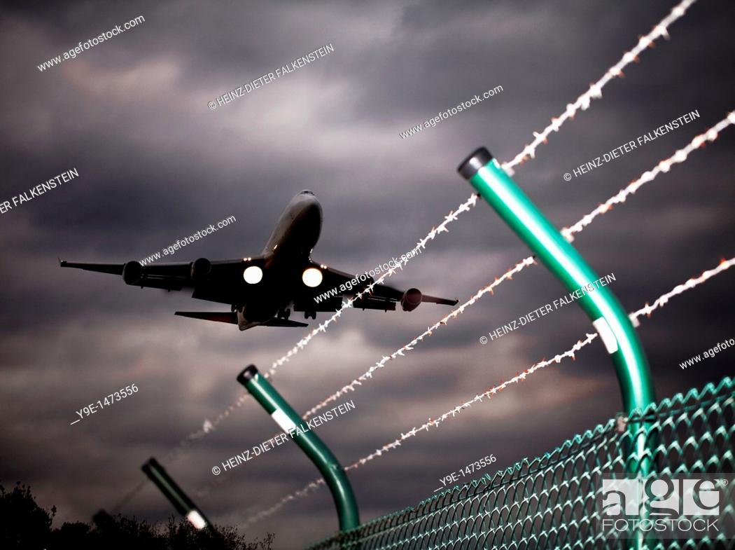 Stock Photo: Plane landing at Cologne Bonn Airport, Wahner Heide nature reserve, Cologne, North Rhine-Westphalia, Germany, Europe.