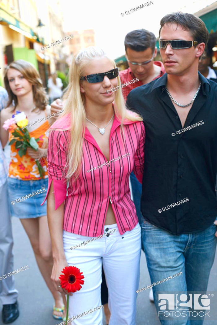 Stock Photo: Young couple walking together.