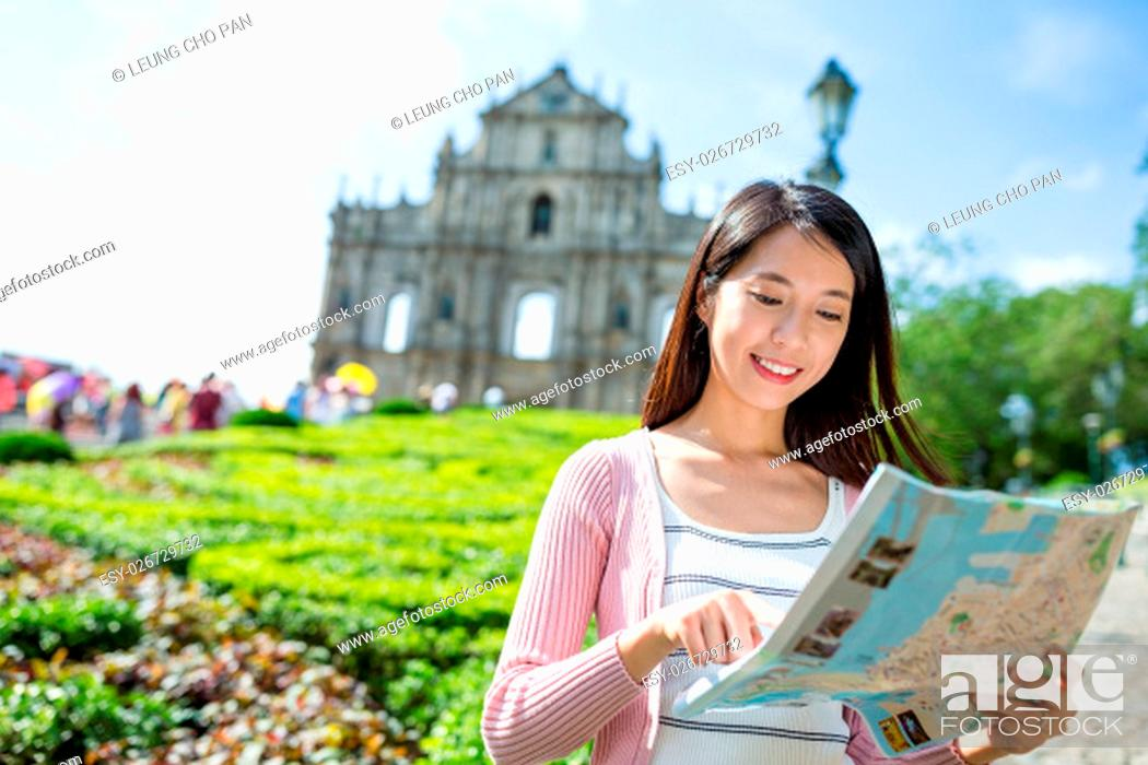 Stock Photo: Woman using city map in Macau city.