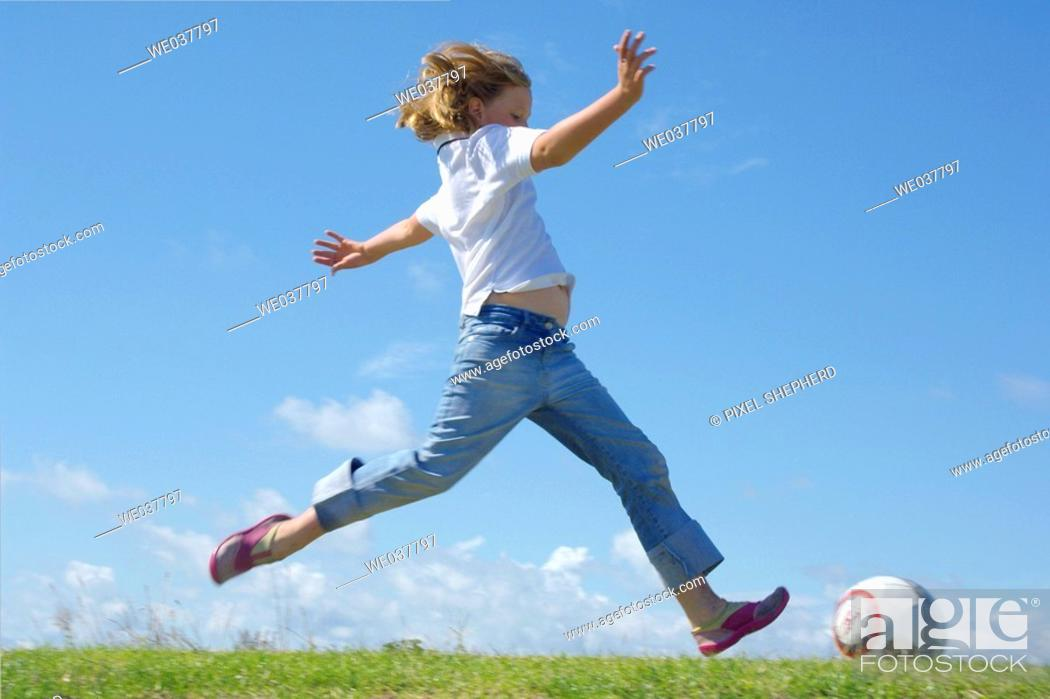 Stock Photo: Girl running along seaside kicking.