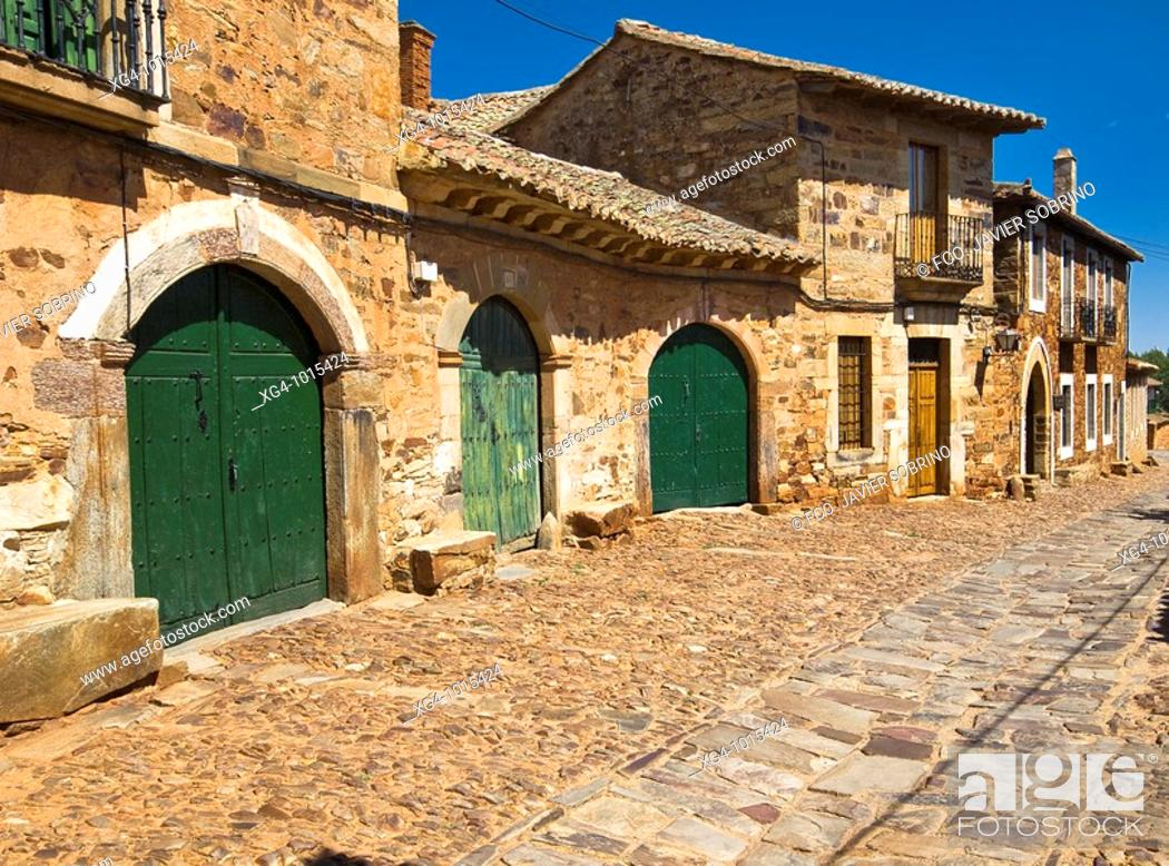 Stock Photo: Cobbled streets and typical houses in the Polvazares Castrillo, population of the Camino de Santiago declared a Historic Artistic - District of Maragatería -.