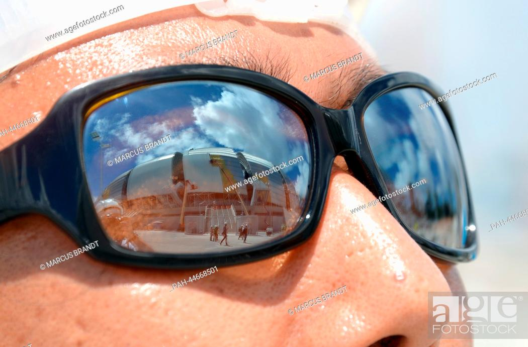 7563280db41 Stock Photo - The Arena das Dunas stadium is mirrored in the sunglasses of  a journalist in Natal