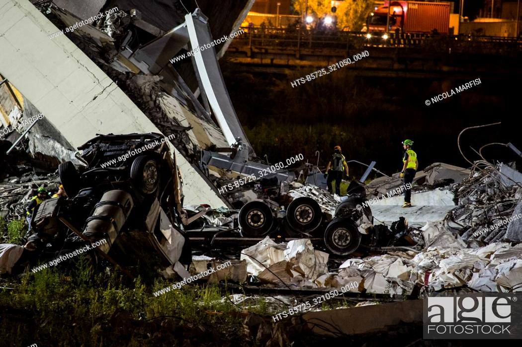 Stock Photo: Genoa, the Morandi Bridge collapses, the A10 motorway viaduct on the Polcevera stream, the searches of the missing continue in the night Genoa, Italy 14/08/2018.