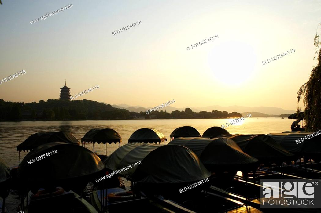 Stock Photo: The Six Harmonies Pagoda and small boats, West Lake in Hangzhou, Zhejiang Province, People Republic of China.