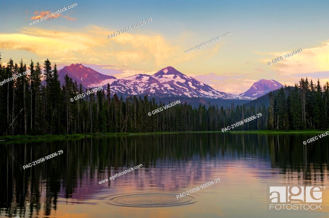 Stock Photo: Oregon, Cascade Mountains, Scott Lake and Three Sisters mountain peaks, Sunset light.