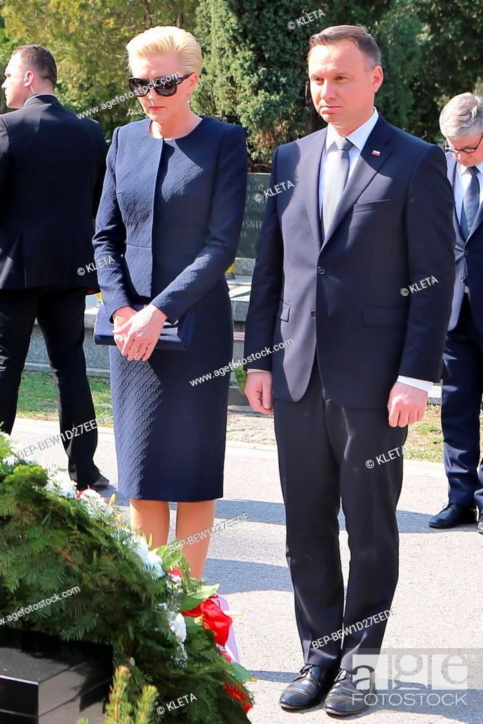 Stock Photo: April 10, 2018 Powazki Cemetery, Warsaw, Poland. Presidential Couple during the deposit wreath ceremony at the monument of to the victims of the Smolensk air.