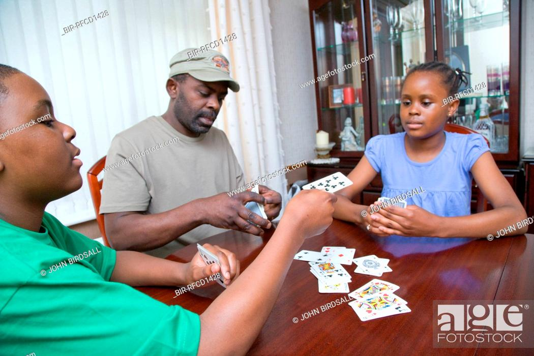 Father Playing A Game Of Cards With His Teenage Daughter And Son Stock Photo Picture And Rights Managed Image Pic Bir Rfcd1428 Agefotostock
