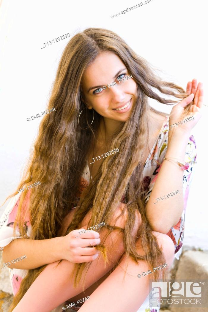 Stock Photo: Happy young woman with a beautiful extra long hair.
