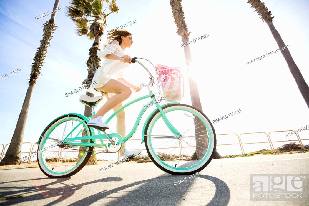Stock Photo: Caucasian woman riding bicycle.