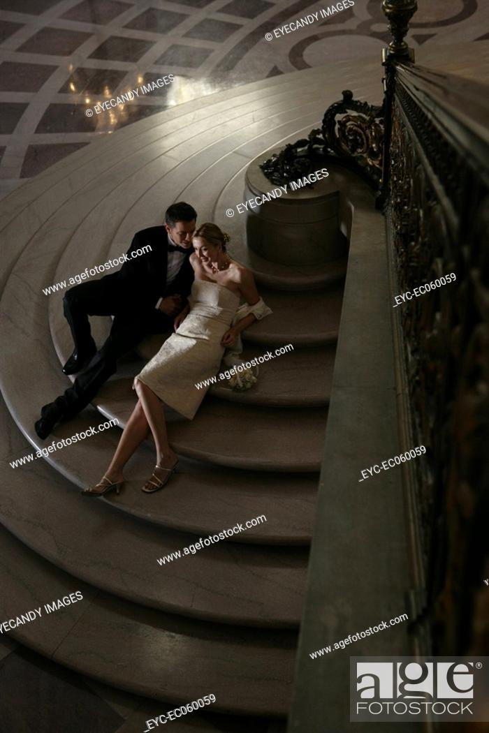 Stock Photo: Couple sitting on step in formal attire.